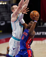 Detroit Pistons guard Hamidou Diallo (6) looks to the basket as Charlotte Hornets center Cody Zeller (40) defends during the second half of an NBA basketball game, Tuesday, May 4, 2021, in Detroit. (AP Photo/Carlos Osorio)