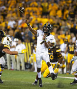 Missouri quarterback Kelly Bryant (7) passes the ball in the fourth quarter against Wyoming during an NCAA college football game Saturday, Aug. 31, 2019, in Laramie, Wyo. (AP Photo/Michael Smith)