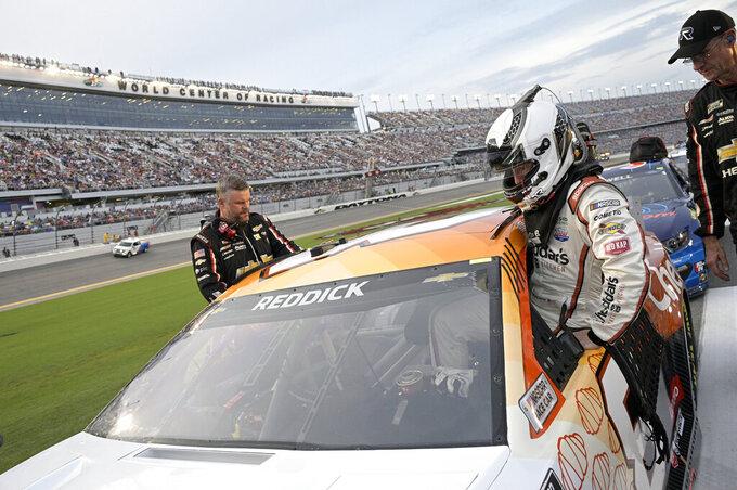 Driver Tyler Reddick gets into his vehicle on pit road prior to the start of a NASCAR Cup Series auto race at Daytona International Speedway, Saturday, Aug. 28, 2021, in Daytona Beach, Fla. (AP Photo/Phelan M. Ebenhack)