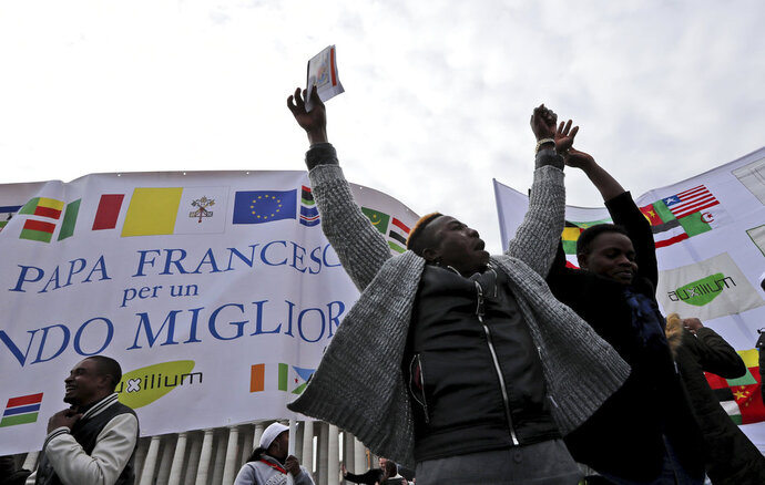 "Faithful dance prior to the Angelus prayer in St. Peter's Square at the Vatican, Sunday, Jan. 14, 2018. Pope Francis says while fear of migrants is ""legitimate' it's a sin if that causes hostility. Francis invited migrants, refugees, asylum-seekers, newly arrived immigrants and second-generation immigrant families to a special Mass he celebrated Sunday in St. Peter's Basilica. (AP Photo/Alessandra Tarantino)"