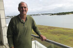 In this Wednesday, Oct. 9, 2019 photo, Beaufort Mayor Rett Newton stands by the waterfront in Beaufort, N.C. Newton says recognizing and responding to climate change is necessary if his 310-year-old town wants to survive rising sea levels (AP Photo / Jeffrey Collins)