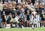 Purdue wide receiver Rondale Moore (4) runs in for a touchdown in front of Boston College defensive back Hamp Cheevers (4) during the first half of an NCAA college football game in West Lafayette, Ind., Saturday, Sept. 22, 2018. (AP Photo/Michael Conroy)
