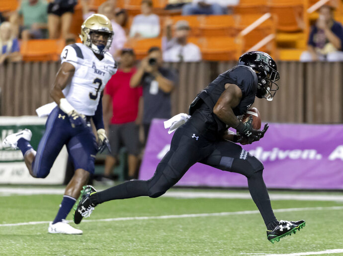 Navy cornerback Cameron Kinley (3) looks as Hawaii wide receiver Cedric Byrd (6) catches a pass for a touchdown in the second half of an NCAA college football game, Saturday, Sept. 1, 2018, in Honolulu. Hawaii beat Navy 59-41. (AP Photo/Eugene Tanner)