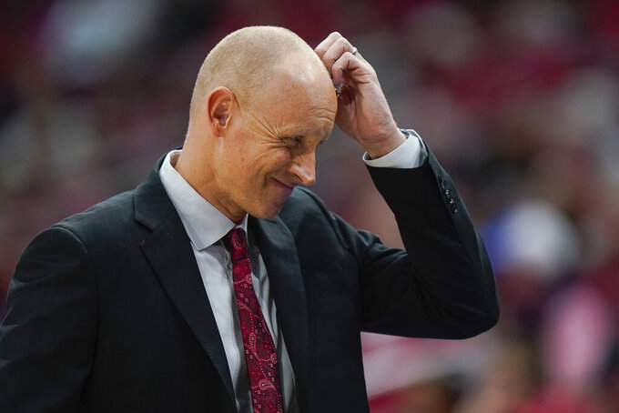 Louisville head coach Chris Mack reacts to a play during the first half of an NCAA college basketball game against Virginia Tech, Sunday, March 1, 2020, in Louisville, Ky. (AP Photo/Bryan Woolston)