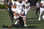 UNLV running back Chad Maygar, top, is tackled by Vanderbilt defender Brendon Harris, bottom, in the first half of an NCAA college football game Saturday, Oct. 12, 2019, in Nashville, Tenn. (AP Photo/Mike Strasinger)
