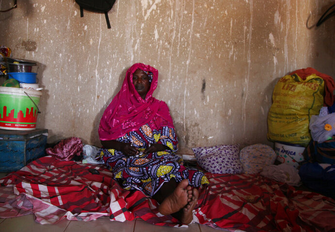 In this April 1, 2019 photo, Ada Diallo recounts a massacre that killed more than 150 people in her village in late March in Bamako, Mali.  It was the deadliest attack yet of a new conflict in the West African nation, one driven by fear and suspicion over alleged ties to extremist groups. (AP Photo/Baba Ahmed)