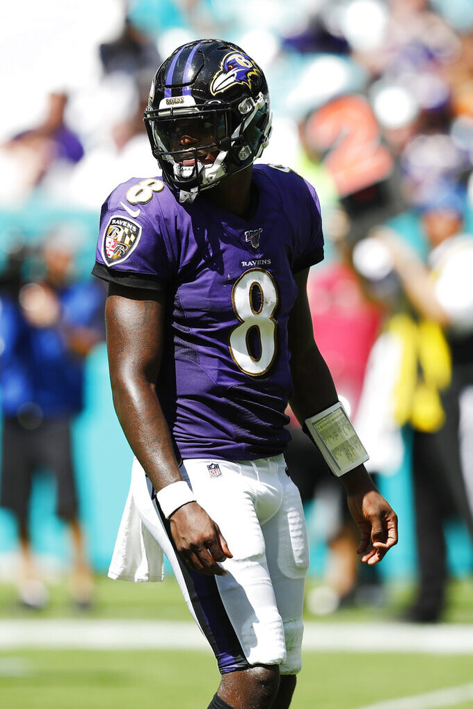 Baltimore Ravens quarterback Lamar Jackson (8) stands on the field between plays, during the second half at an NFL football game against the Miami Dolphins, Sunday, Sept. 8, 2019, in Miami Gardens, Fla. (AP Photo/Brynn Anderson)
