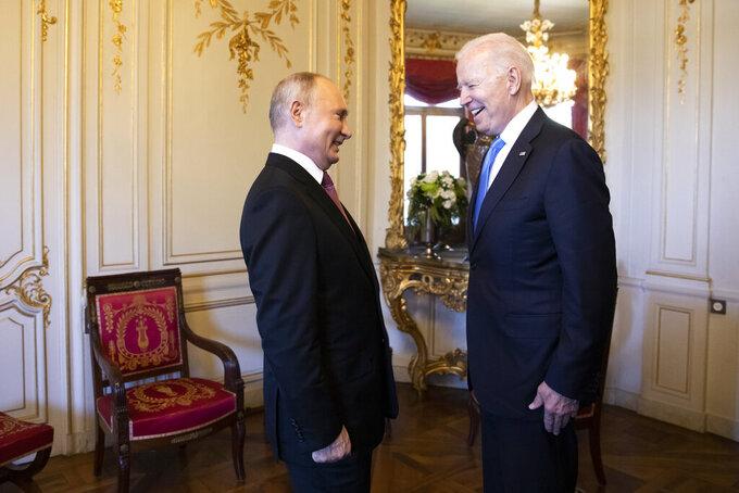 Russian president Vladimir Putin, left, talks with U.S. President Joe Biden, right, during the U.S. - Russia summit in Geneva, Switzerland, Wednesday, June 16, 2021. (Peter Klaunzer/Swiss Federal Office of Foreign Affairs via AP)