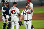 Atlanta Braves relief pitcher Grant Dayton, right, walks off the mound after being relieved in the fifth inning of a baseball game against the Boston Red Sox on Saturday, Sept. 26, 2020, in Atlanta. (AP Photo/John Bazemore)