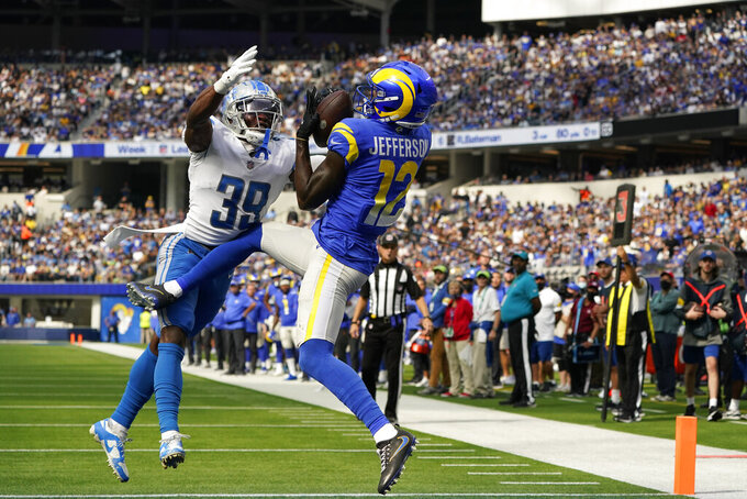 Los Angeles Rams wide receiver Van Jefferson, right, hauls in a touchdown pass in the end zone as Detroit Lions cornerback Jerry Jacobs defends during the first half of an NFL football game Sunday, Oct. 24, 2021, in Inglewood, Calif.(AP Photo/Marcio Jose Sanchez)
