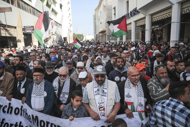 People gather for a demonstration in Rabat, Morocco, Sunday, Feb. 9, 2020. Thousands of Moroccans took part in a march rejecting Trump's Middle East peace plan and in support of Palestinians. (AP Photo/Mosa'ab Elshamy)