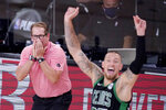 Toronto Raptors head coach Nick Nurse, left, and Boston Celtics' Daniel Theis (27) react during the second half of an NBA conference semifinal playoff basketball game Friday, Sept. 11, 2020, in Lake Buena Vista, Fla. (AP Photo/Mark J. Terrill)