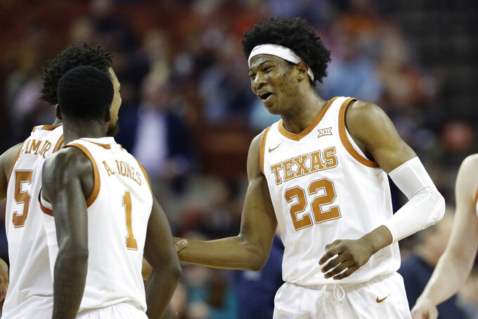 Texas forward Kai Jones (22) celebrates a play with teammates during the second half of an NCAA college basketball game against West Virginia, Monday, Feb. 24, 2020, in Austin, Texas. (AP Photo/Eric Gay)