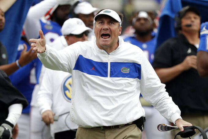 Florida head coach Dan Mullen disputes a call by officials during the first half of an NCAA college football game against Georgia, Saturday, Nov. 2, 2019, in Jacksonville, Fla. (AP Photo/John Raoux)
