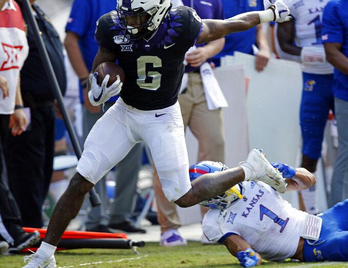 TCU Horned Frogs running back Darius Anderson (6) runs in the first half, tackled by Kansas Jayhawks safety Bryce Torneden (1) at Amon Carter Stadium in Fort Worth, Texas Saturday, Sept. 28, 2019.  (David Kent/Star-Telegram via AP)