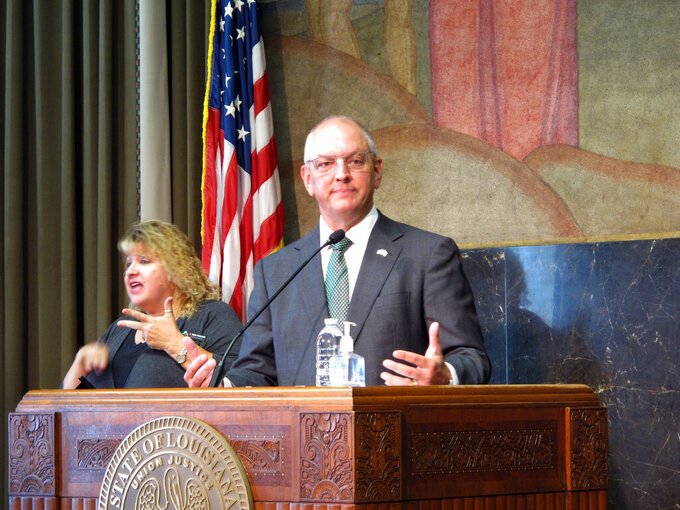 Louisiana Gov. John Bel Edwards speaks about the state's latest surge in coronavirus cases, on Friday, July 23, 2021, in Baton Rouge, La. Edwards recommends that his state's residents return to wearing masks indoors, whether they are vaccinated against COVID-19 or not, if they are unable to distance from people. (AP Photo/Melinda Deslatte)
