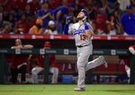 Los Angeles Dodgers' Max Muncy gestures as he scores after hitting a solo home run during the third inning of the team's baseball game against the Los Angeles Angels on Tuesday, June 11, 2019, in Anaheim, Calif. (AP Photo/Mark J. Terrill)