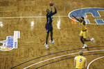Oral Roberts forward DeShang Weaver shoots a 3-pointer against North Dakota State during an NCAA college basketball game for the  Summit League men's tournament championship Tuesday, March 9, 2021, in Sioux Falls, S.D. (AP Photo/Josh Jurgens)