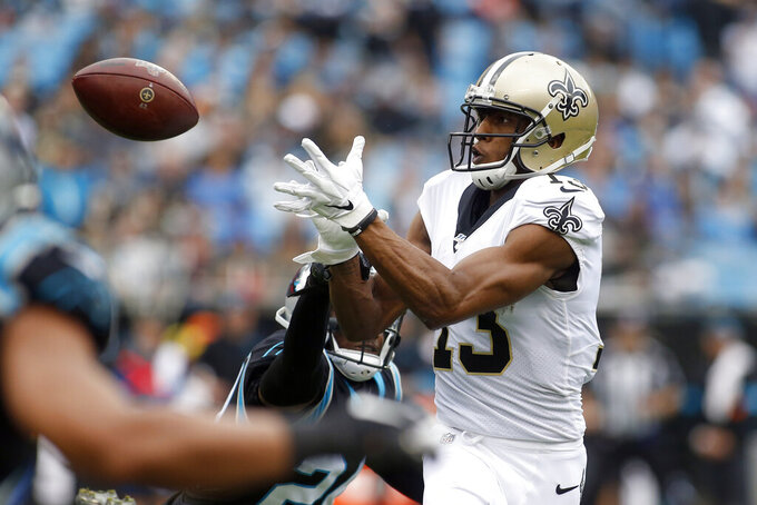New Orleans Saints wide receiver Michael Thomas (13) reaches for a pass during the first half of an NFL football game against the Carolina Panthers in Charlotte, N.C., Sunday, Dec. 29, 2019. (AP Photo/Brian Blanco)