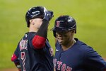 Boston Red Sox's Christian Vazquez, left, and Rafael Devers celebrate after Devers hit a solo home run during the third inning of the team's baseball game against the Texas Rangers in Arlington, Texas, Friday, April 30, 2021. (AP Photo/Tony Gutierrez)