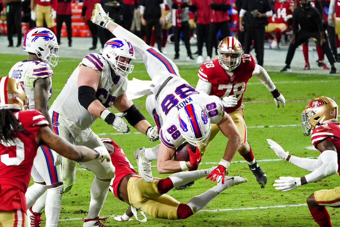 Buffalo Bills tight end Dawson Knox (88) is hit by San Francisco 49ers free safety Jimmie Ward during the second half of an NFL football game, Monday, Dec. 7, 2020, in Glendale, Ariz. (AP Photo/Rick Scuteri)