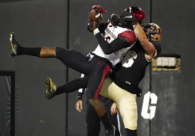 Colorado tight end C.J. Schmanski, right, grabs San Diego State safety Dwayne Johnson Jr. as he breaks up an interception attempt duirng the second half of an NCAA college football game Saturday, Nov. 28, 2020, in Boulder, Colo. (AP Photo/David Zalubowski)