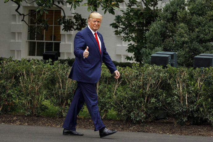 President Donald Trump gives the thumbs-up as he arrives for a ceremony on the South Lawn of the White House in Washington, Thursday, Sept. 26, 2019. The president was given a plaque of appreciation from America's Sheriffs and Angel Families. (AP Photo/Carolyn Kaster)