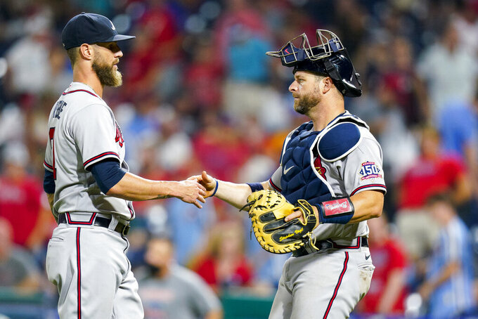 Atlanta Braves relief pitcher Shane Greene, left, celebrates with catcher Stephen Vogt after the team's 15-3 win in a baseball game against the Philadelphia Phillies, Saturday, July 24, 2021, in Philadelphia. (AP Photo/Chris Szagola)