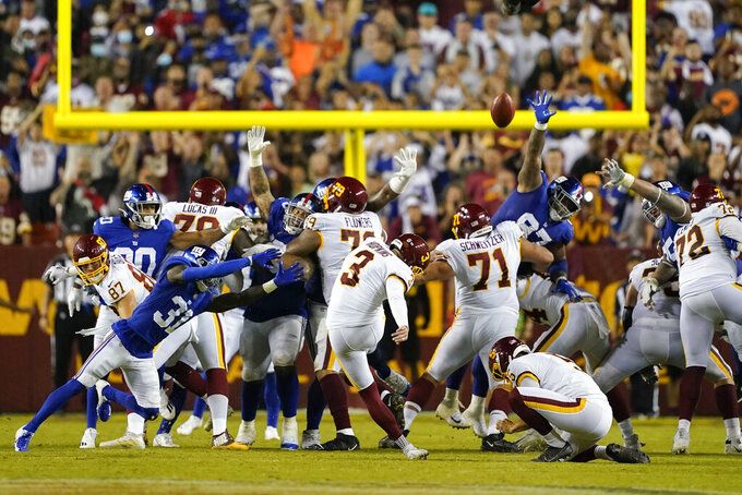 Washington Football Team kicker Dustin Hopkins (3) hits the winning field goal against the New York Giants at the end of an NFL football game, Thursday, Sept. 16, 2021, in Landover, Md. Washington won 30 - 29. (AP Photo/Al Drago)