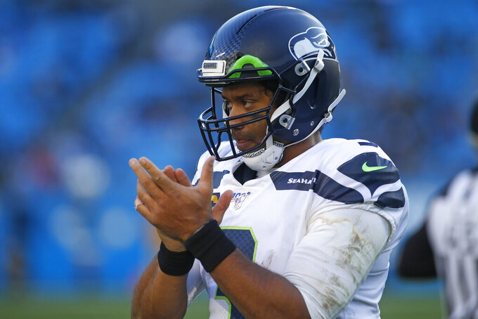 Seattle Seahawks quarterback Russell Wilson (3) reacts during the second half of an NFL football game against the Carolina Panthers in Charlotte, N.C., Sunday, Dec. 15, 2019. (AP Photo/Brian Blanco)