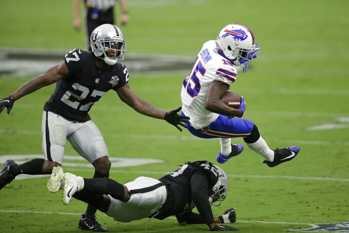 Las Vegas Raiders inside linebacker Cory Littleton (42) tackles Buffalo Bills wide receiver John Brown (15) during the first half of an NFL football game, Sunday, Oct. 4, 2020, in Las Vegas. (AP Photo/Isaac Brekken)