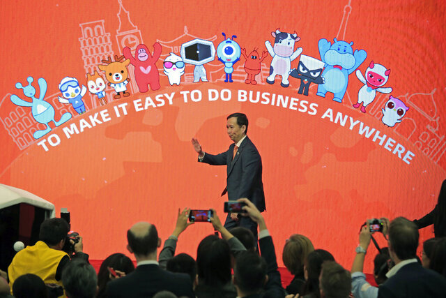 FILE - In this file photo dated Tuesday, Nov. 26, 2019, Chairman and CEO of Alibaba Group Daniel Zhang Yong attends the Alibaba Group's listing ceremony at the Hong Kong Stock Exchange (HKEX) in Hong Kong.  Known globally as an online retail platform, Alibaba chief marketing officer Chris Tung announced Wednesday Jan. 15, 2020, plans to change how broadcasters, fans and organizers experience the Olympic Games. (AP Photo/Kin Cheung, FILE)