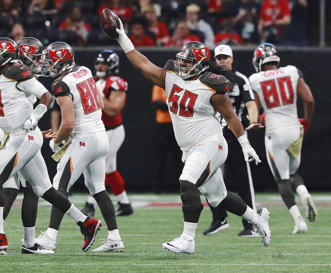 Tampa Bay Buccaneers defensive lineman Vita Vea (50)celebrates his touchdown catch during the second quarter of an NFL football game against the Atlanta Falcons, Sunday, Nov. 24, 2019, in Atlanta. (Curtis Compton/Atlanta Journal-Constitution via AP)