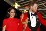 "FILE - In this Saturday March 7, 2020 file photo, Britain's Prince Harry and Meghan, Duchess of Sussex arrive at the Royal Albert Hall in London, , to attend the Mountbatten Festival of Music. Prince William infuriated Prince Harry when he told his younger brother he should move slowly in his relationship with the former Meghan Markle, fearing that he was  being ""blindsided by lust,'' a new book on the Windsors says. The second installment of a serialized version of the book ""Finding Freedom,"" which appeared in the Sunday Times, Sunday, July 26, 2020 claimed that Harry was angered by what he perceived to be as William's snobby tone in a discussion about the American actress. (Simon Dawson/Pool via AP, file)"