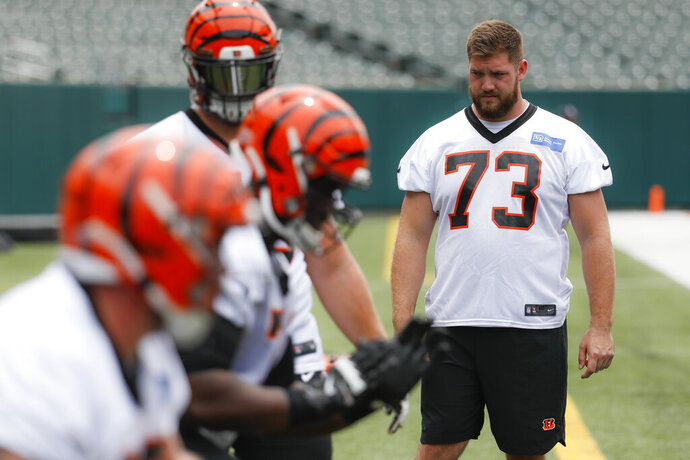 Cincinnati Bengals offensive tackle Jonah Williams stands on the sidelines during practice at the team's NFL football facility, Wednesday, June 12, 2019, in Cincinnati. (AP Photo/John Minchillo)