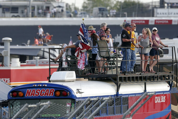 Fans watch during the NASCAR Cup Series auto race at Charlotte Motor Speedway in Concord, N.C., Sunday, Sept. 29, 2019. (AP Photo/Gerry Broome)