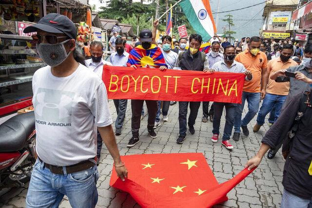Exile Tibetans and local Indians participate in a protest against the Chinese government in Dharmsala, India, Friday, June 19, 2020. India said Thursday it was using diplomatic channels with China to de-escalate a military standoff in a remote Himalayan border region where 20 Indian soldiers were killed this week. (AP Photo/Ashwini Bhatia)