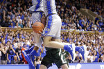 Colorado State forward Adam Thistlewood (31) drives between Duke forward Joey Baker, right and forward Javin DeLaurier during the first half of an NCAA college basketball game in Durham, N.C., Friday, Nov. 8, 2019. (AP Photo/Gerry Broome)