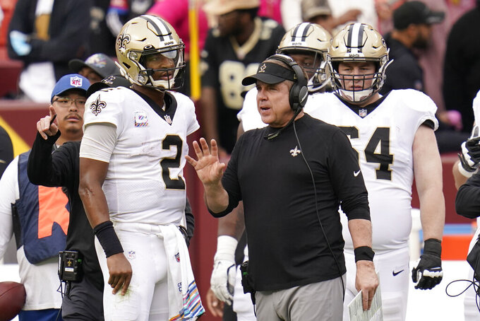New Orleans Saints head coach Sean Payton speaks with quarterback Jameis Winston (2) in the second half of an NFL football game against the Washington Football Team, Sunday, Oct. 10, 2021, in Landover, Md. (AP Photo/Julio Cortez)