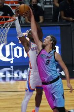Oklahoma City Thunder guard Shai Gilgeous-Alexander (2) blocks a shot at the basket by Miami Heat forward Kelly Olynyk (9) during the second half of an NBA basketball game, Monday, Jan. 4, 2021, in Miami. (AP Photo/Marta Lavandier)