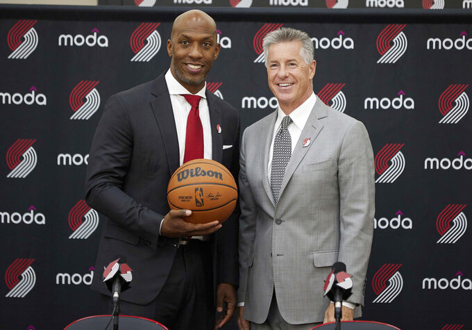 Neil Olshey, right, and Chauncey Billups pose after Billups was announced as the head coach of the Portland Trail Blazers at the team's practice facility in Tualatin, Ore., Tuesday, June 29, 2021. (AP Photo/Craig Mitchelldyer)