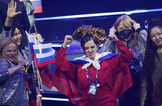 Manizha from Russia celebrates qualifying after the first semifinal of the Eurovision Song Contest at Ahoy arena in Rotterdam, Netherlands, Tuesday, May 18, 2021. (AP Photo/Peter Dejong)