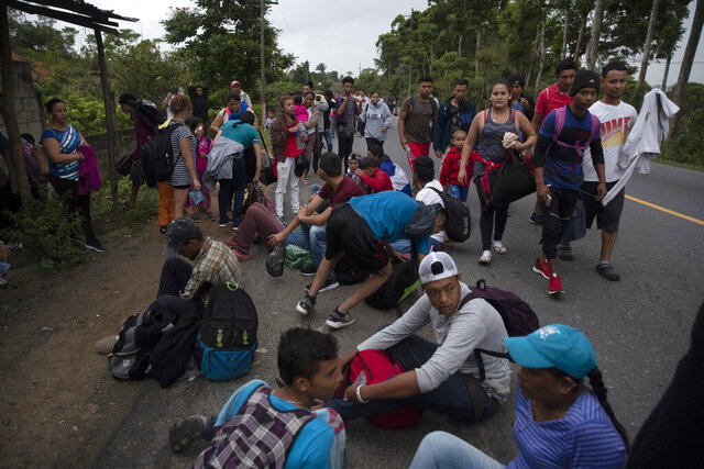 Migrants from Honduras rest during their journey to reach the United States, in Entre Rios, Guatemala, Thursday, Jan. 16, 2020. Hundreds of migrants arrived at the Guatemala border after walking and hitching rides from San Pedro Sula, Honduras in a bid to form the kind of migrant caravan that reached the U.S. border in 2018. (AP Photo/Moises Castillo)