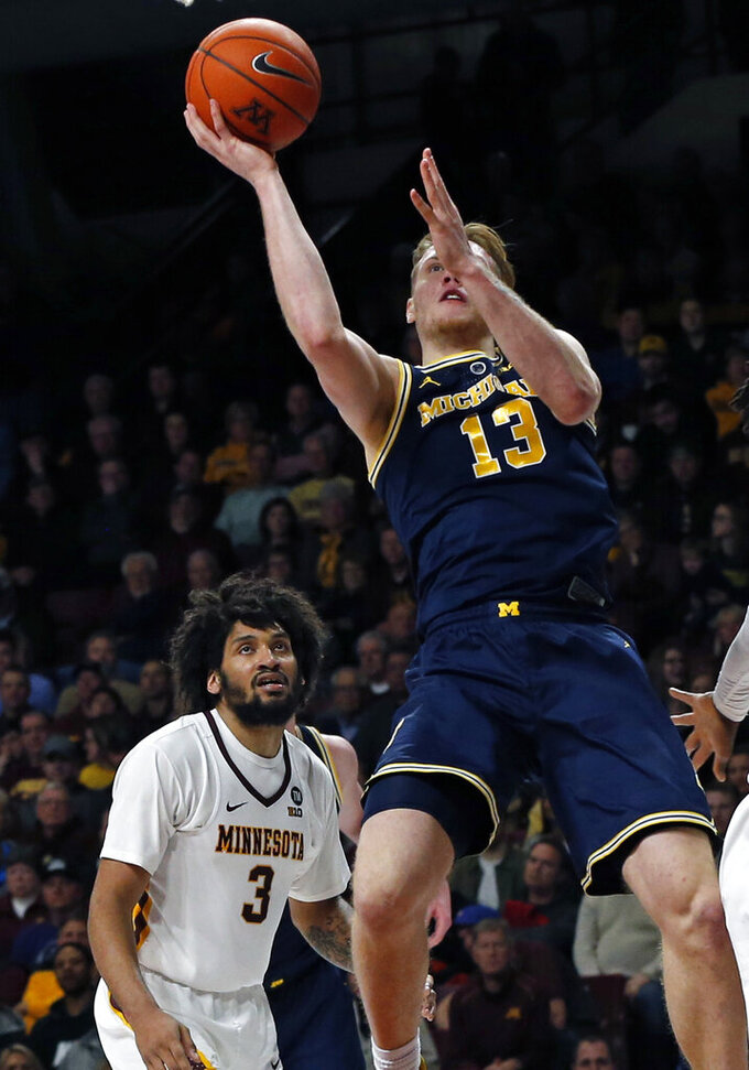 Poole has 22 points, No. 7 Michigan beats Minnesota 69-60