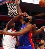 Washington Wizards center Thomas Bryant (13) fouls Detroit Pistons center Andre Drummond (0) during the first half of an NBA basketball game, Monday, Feb. 11, 2019, in Detroit. (AP Photo/Carlos Osorio)