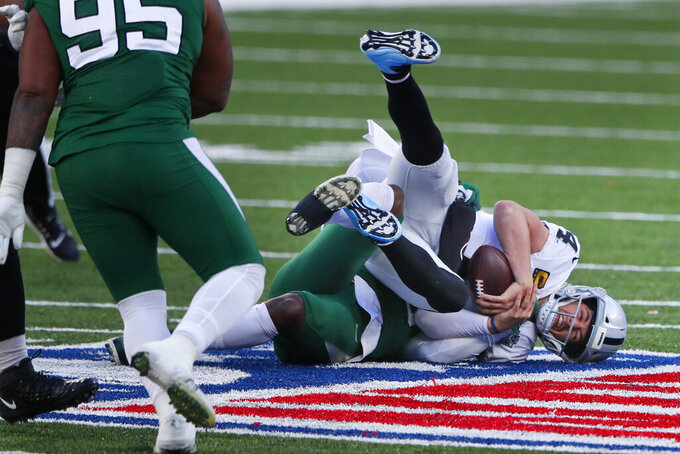 Las Vegas Raiders quarterback Derek Carr is sacked during the first half of an NFL football game against the New York Jets, Sunday, Dec. 6, 2020, in East Rutherford, N.J. (AP Photo/Noah K. Murray)