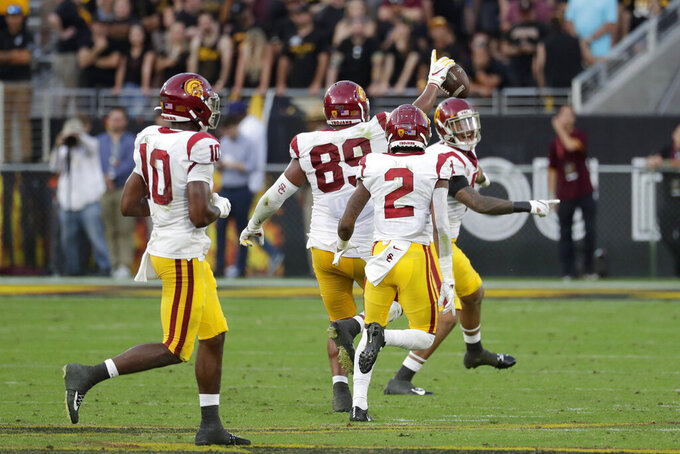 Southern California defensive lineman Christian Rector (89) celebrates his game-ending interception against Arizona State during the second half of an NCAA college football game, Saturday, Nov. 9, 2019, in Tempe, Ariz. (AP Photo/Matt York)