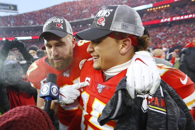Kansas City Chiefs' Travis Kelce and Patrick Mahomes, right, celebrate after the NFL AFC Championship football game against the Tennessee Titans Sunday, Jan. 19, 2020, in Kansas City, MO. The Chiefs won 35-24 to advance to Super Bowl 54. (AP Photo/Charlie Neibergall)