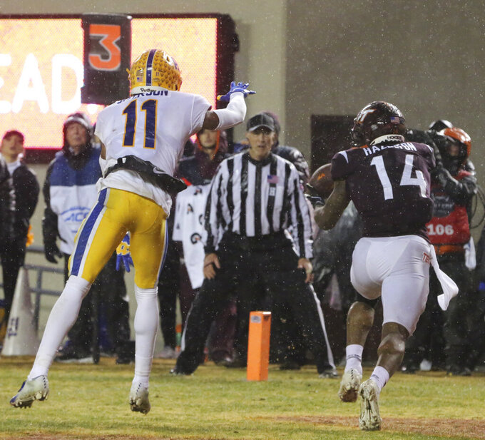 Damon Hazelton (14) of Virginia Tech catches a two yard touchdown pass from quarterback Hendon Hooker past Pittsburgh defender Dane Jackson (11) in the fourth quarter of an NCAA college football game in Blacksburg Va. Saturday, Nov. 23 2019. (Matt Gentry/The Roanoke Times via AP)