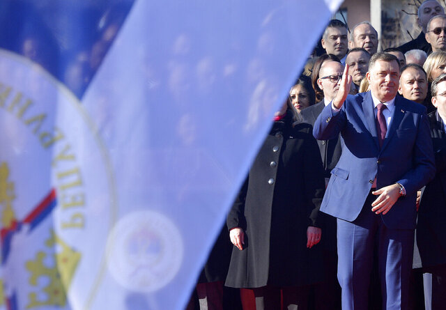 Serb member of the tripartite Presidency of Bosnia and Herzegovina Milorad Dodik, right, gestures during a parade marking the 28th anniversary of the Republic of Srpska in Banja Luka, Bosnia, Tuesday, Jan. 7, 2020. Bosnia's Serbs celebrated on Thursday their self-declared holiday that has been disputed as discriminatory by the country's other ethnic groups and its top court. (AP Photo/Radivoje Pavicic)